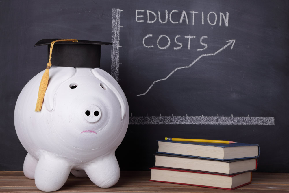 piggy bank with chart of rising education costs